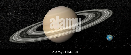 Large planet Saturn and its rings next to small planet Earth. - Stock Photo