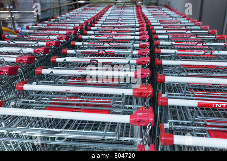 Shopping carts of Interspar supermarket in rows - Stock Photo