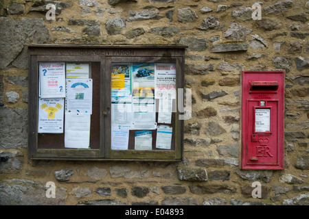 Amenities for residents - close-up of leaflets & notices pinned to Buckden Parish notice board by village post box - Stock Photo