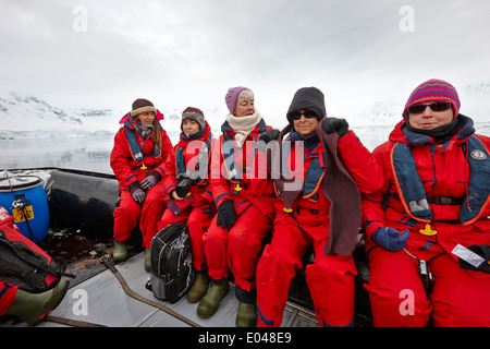 women passengers on board a zodiac during excursion in antarctica - Stock Photo