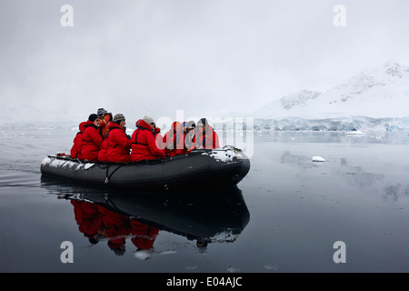 passengers on board a zodiac in fournier bay on excursion in antarctica - Stock Photo