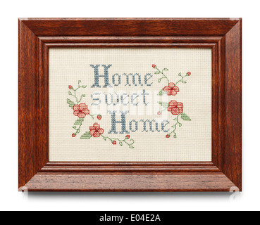 Cross Stitch in Wood Frame Isolated on White Background. - Stock Photo