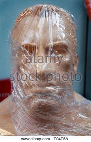 wrapped up in clear celophane boxer face punch mannequin - Stock Photo
