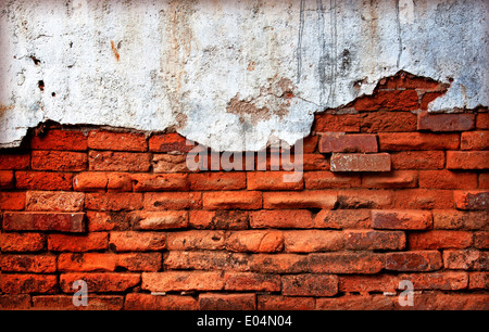 Old red brick wall damage decay erosion. - Stock Photo