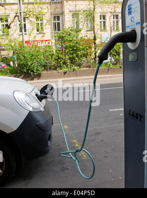 Berlin, Germany. 23rd Apr, 2014. A car is being recharged at a charging station for electric powered vehicles in - Stock Photo