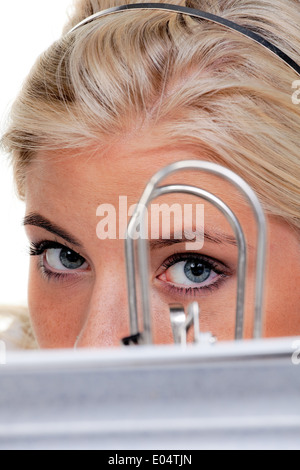 Young woman with a pile of acts folder:, Junge Frau mit einem Stapel Akten Ordner: - Stock Photo