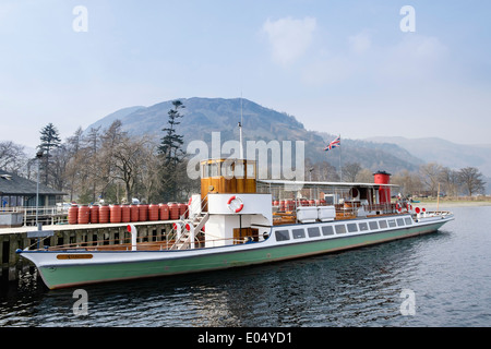 Old Steamer 'Raven' at Pier Head for Ullswater Steamers in Lake District National Park Glenridding Cumbria England - Stock Photo