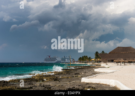 Dark storm clouds gather over a beach resort. Cozumel, Mexico. - Stock Photo