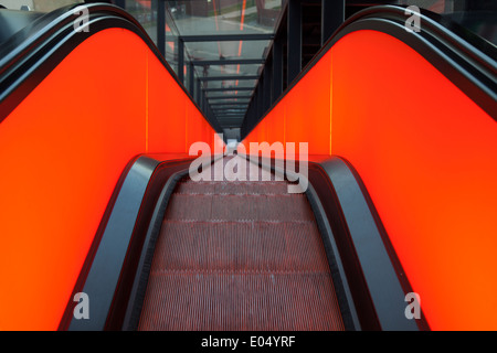 Neon lit escalator up to the museum in the main building of the Zeche Zollverein UNESCO heritage - Stock Photo