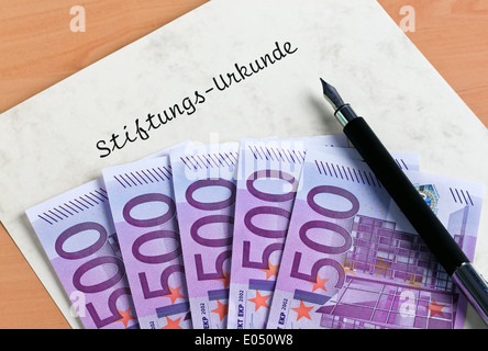 A lot of euro of bank notes and document of an endowment, Viele Euro Geldscheine und Urkunde einer Stiftung - Stock Photo