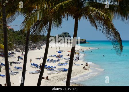 Dupont Xanadu mansion at white sand beach through palm trees at  Varadero resort Cuba and turquoise ocean - Stock Photo