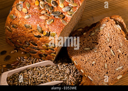 A fresh bread with pumpkin cores to the healthy food. Cakes and pastries of brown bread, Ein frisches Brot mit Kuerbiskernen - Stock Photo