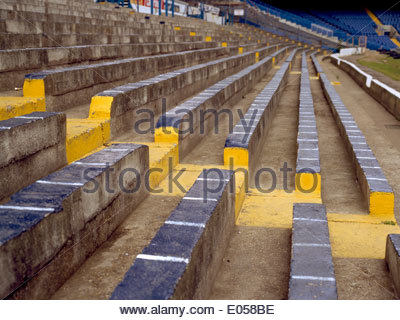 Cold bench seats at Stamford Bridge, home of Chelsea Football Club, of England. - Stock Photo