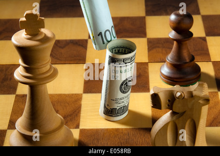 Chess with dollar and euro of bank note. Symbol for devaluation of the dollar against euro., Schach mit Dollar und - Stock Photo