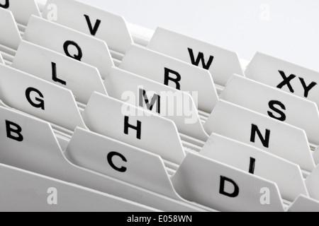 A white card index map box with alphabetical assortment, Ein weisser Kartei Kartenkasten mit alphabetischer Sortierung - Stock Photo