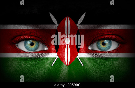 Human face painted with flag of Kenya - Stock Photo