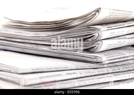 Old newspapers and magazines on a pile, Alte Zeitungen und Zeitschriften auf einem Stapel - Stock Photo