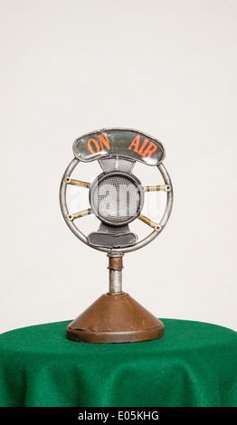 Old microphone with on air sign - Stock Photo