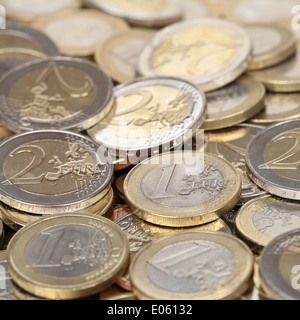 Stack of one and two Euro coins from Europe - Stock Photo