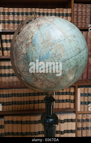 Old globe and journals, Carlsberg Laboratory, Copenhagen, Denmark - Stock Photo