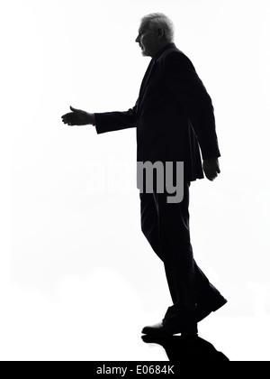 One Caucasian Senior Business Man walking handshake Silhouette White Background - Stock Photo