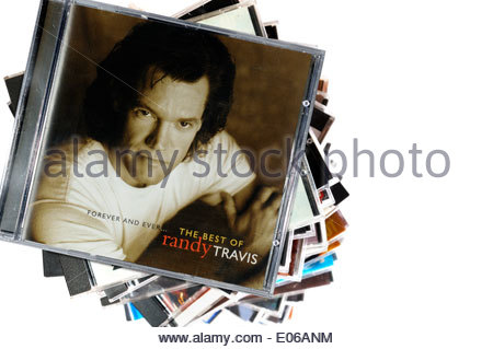 Randy Travis album Forever and Ever, piled music CD cases, England - Stock Photo