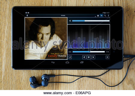 Randy Travis album Forever and Ever, MP3 album art on PC tablet, England - Stock Photo