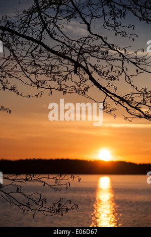 Bright sunset on the Saimaa lake in Finland - Stock Photo