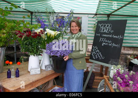 Lady selling 100% British grown flowers, Powderham Castle, Exeter, UK. 03rd May, 2014. Toby Buckland's Garden Festival. - Stock Photo