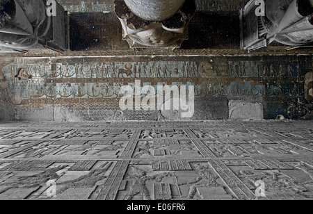 Egypt,Dendera,Ptolemaic temple of the goddess Hathor.View of ceiling and columns before cleaning. - Stock Photo