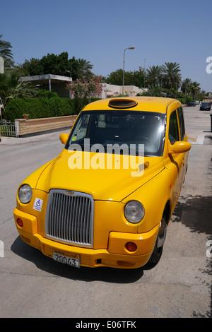 Bahrain Taxi on a compound in Barbar, Kingdom of Bahrain - Stock Photo