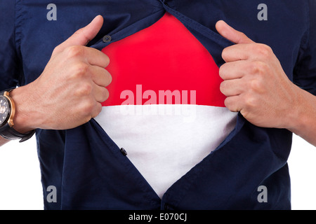 Young sport fan opening his shirt and showing the flag his country Indonesia - Stock Photo