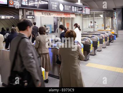 People entering Tokyo metro subway station turnstiles. Shibuya, Tokyo, Japan. - Stock Photo