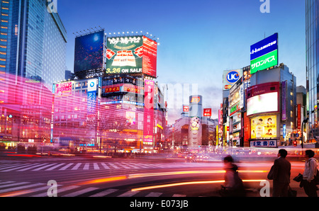 Colorful city scenery with traffic light trails at intersection in Shibuya, Tokyo, Japan during sunset. 2014 - Stock Photo