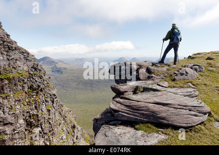 A lone hillwalker on The Black Notch (Eag Dubh) on the traverse of Beinn Alligin in the Torridon area of Scotland - Stock Photo