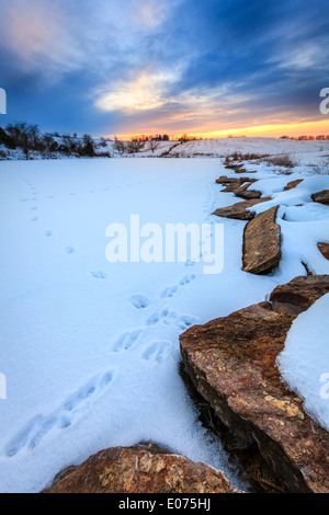 Sunset on a frozen lake in Central Kentucky - Stock Photo