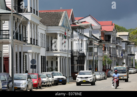 Dutch colonial houses at Waterkant street (Waterfront) in Paramaribo, capital of Suriname, South America - Stock Photo