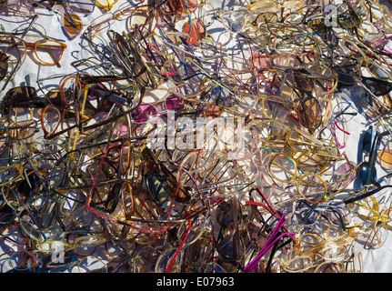 A heap of second hand glasses on a street market - Stock Photo