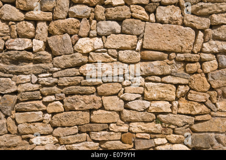 antique wall built with roman times stones - Stock Photo