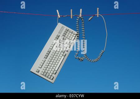Illustration - A computer keyboard hangs from a clothes line in Germany, 14 June 2013. Photo: Berliner Verlag/Steinach - Stock Photo