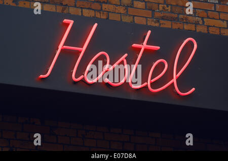 Berlin-Prenzlauer Berg, Germany. 26th Sep, 2009. A red neon sign reading 'Hostel' is lit at the facade of the Pfefferbett - Stock Photo