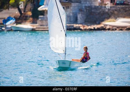 Boy in a sailboat, Hvar island, Croatia - Stock Photo