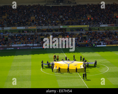 Inside Molineux Stadium home of Wolverhampton Wanderers Football Club with large shirt replica in the centre circle - Stock Photo