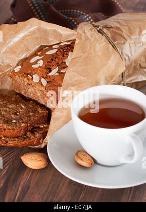 Delicious freshly baked banana bread on wooden board - Stock Photo