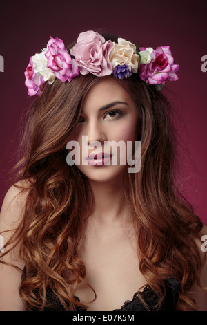 Young woman wearing flower wreath - Stock Photo
