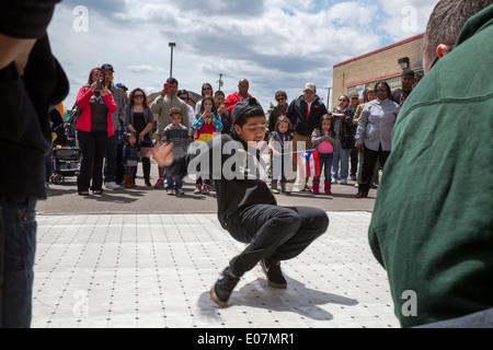 Detroit, Michigan - A breakdance demonstration at the Blessing of the Lowriders. - Stock Photo