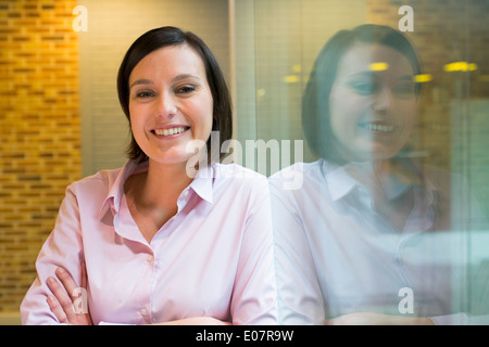 Female business startup looking camera student - Stock Photo