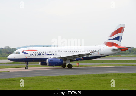 A British, Airways, Airbus, A319 (G-EUPS) taxiing on the runway at Manchester Airport - Stock Photo