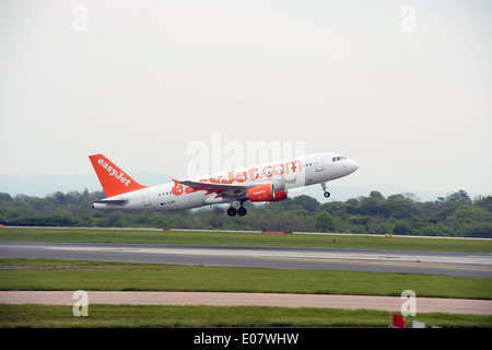 Easyjet plane taking off at Manchester Airport - Stock Photo