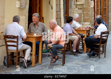 Group men at Greek outdoor café some playing backgammon others are chatting Chania Town Crete Greece Situated on - Stock Photo